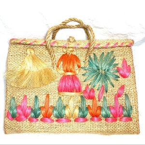 "Embroidered straw bag ""Haiti"" stitched on top."